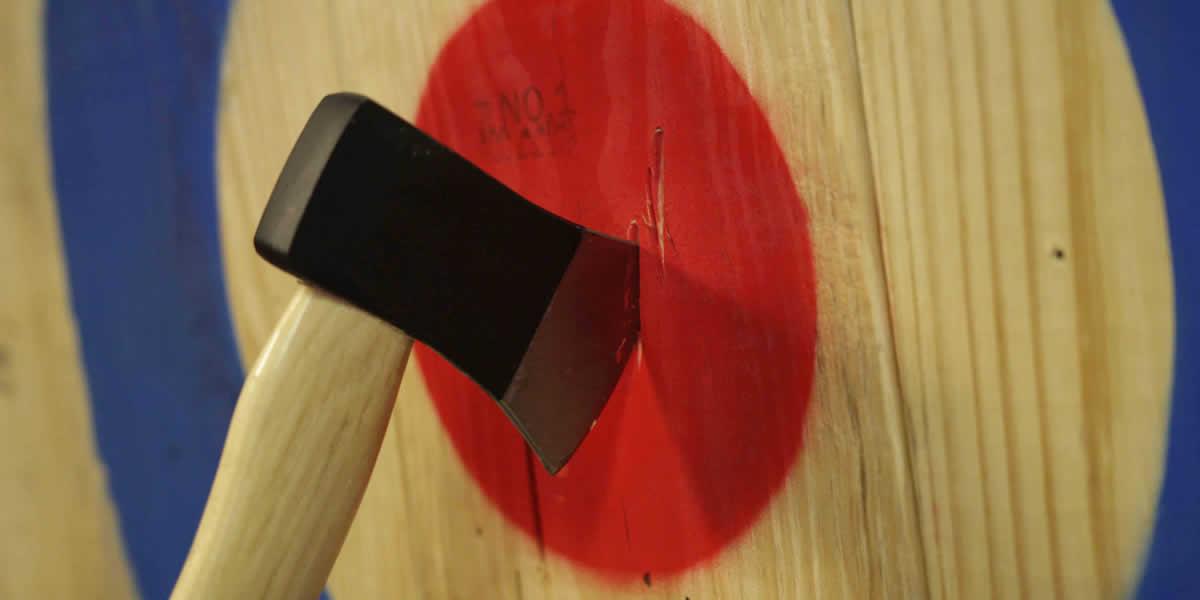 axe in bullseye at the castle axe throwing